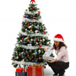 Opening Christmas presents near decorated tree — Stock Photo