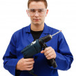 Young worker holding drilling machine — Stock Photo #6897016