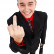 Smiling cynical businessman showing middle-finger — Stock Photo #6897035