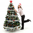 Woman standing near decorated Christmas tree — Stock Photo