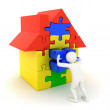 White man pushing in place puzzle house piece — Stock Photo