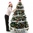 Woman decorating Christmas tree — Stock Photo #6897305