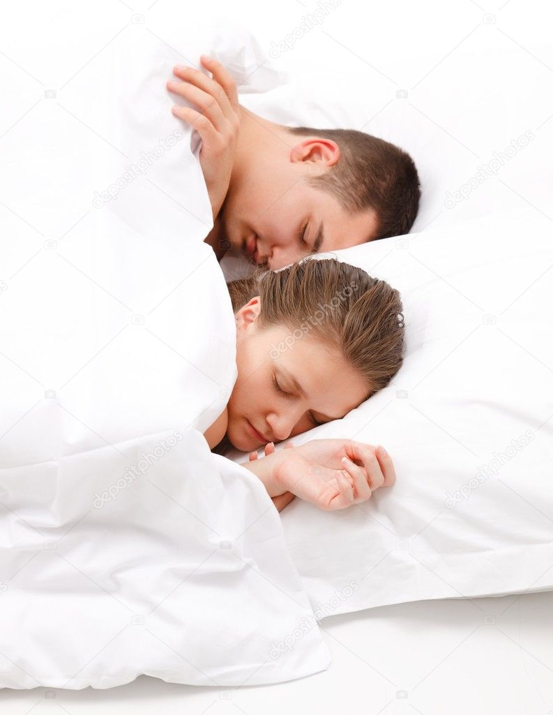 Young couple sleeping alongside each other in bed  Stock Photo #6897261