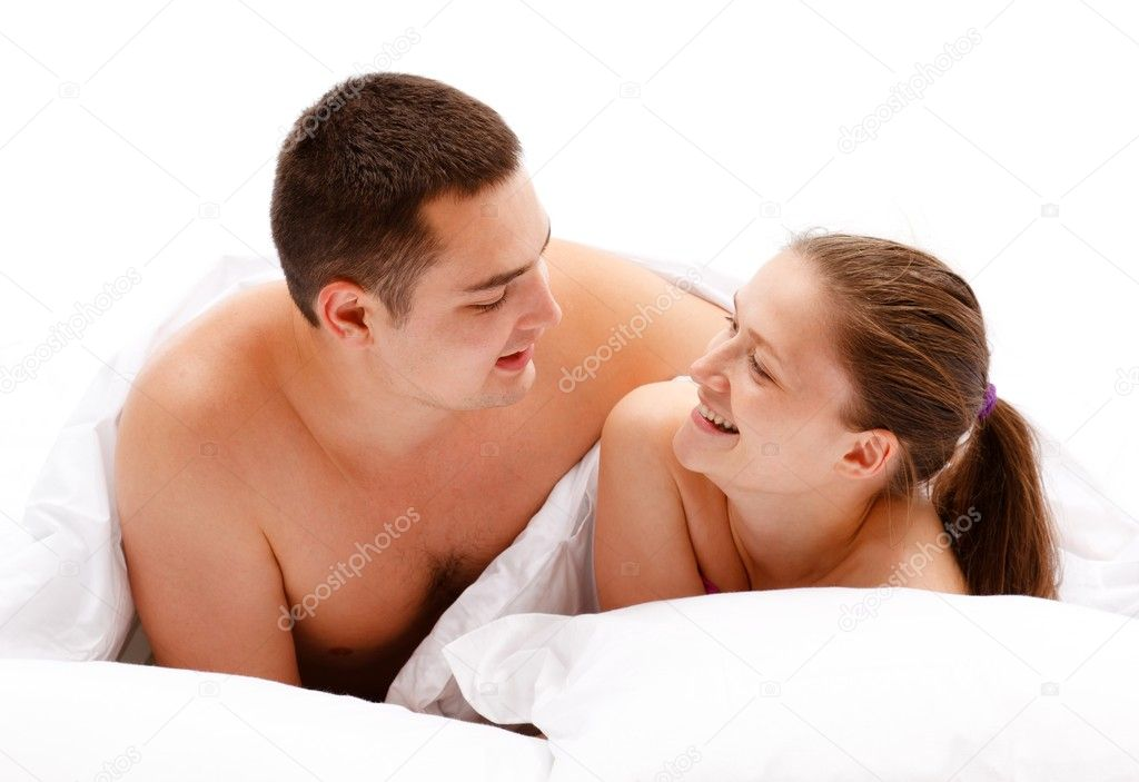 Young naked couple smiling to each other in bed  Stock Photo #6897262