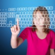 Girl pressing enter on virtual keyboard - Stock Photo