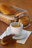 Tea cup and bread on table — Stock Photo