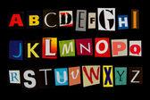 Coloured criminal font isolated on black — Stock Photo