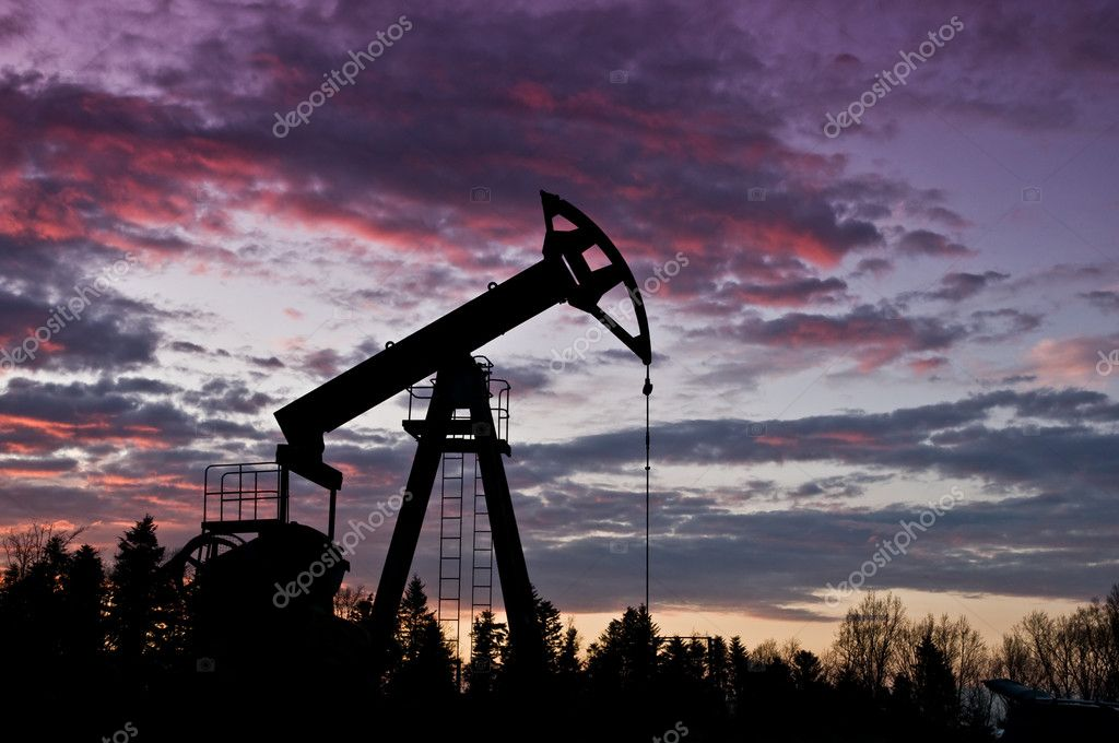 Oil pump against red sunset — Stock Photo #7188101