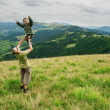 Son on father hand in mountain — Stockfoto
