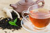 Tea in cup on sacking fabric — Stock Photo