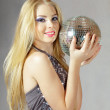 Blond woman with disco ball — Stock Photo