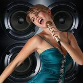 Beautiful yong singer — Stock Photo