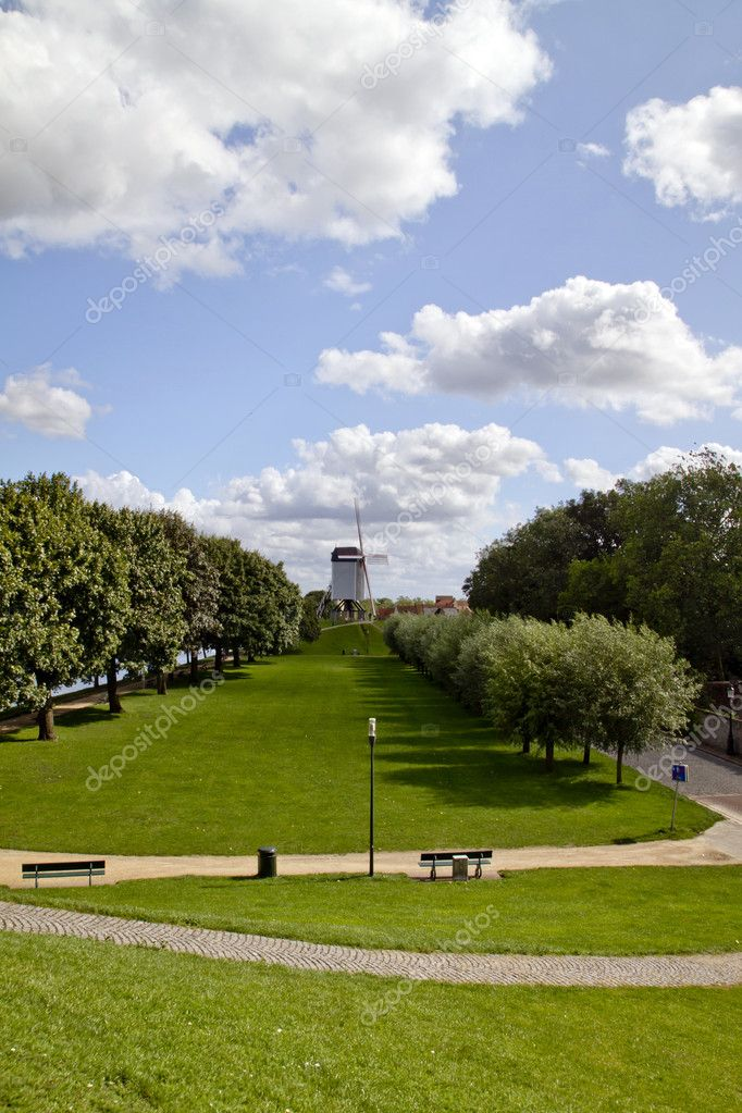 Park With Windmill. Bruges, Belgium — Stock Photo #6863999