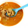 Pork spicy curry with blue spoon — Stock Photo