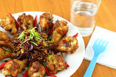 Part of spicy herb fried chicken wings on the table. — Stock Photo