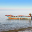 Old fisher boat with engine near beach. — Stock Photo