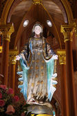 Mary statue near the shrine in church — Stock Photo