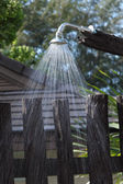Flowing water of outdoor shower in tropical resort. — Stock Photo