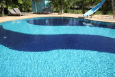 Pool with two shade tile. — Stock Photo