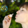 Young girl inflates soap bubbles — Stock Photo #7000867