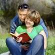 Man and woman read the book — Stock Photo