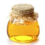 Honey on white background — Stock Photo