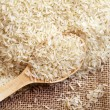 Stock Photo: Rice in wooden spoon