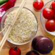 Raw rice with tomato - Stock Photo