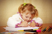 Portrait of a young beautiful girl. A girl is engaged in drawing — Stock Photo