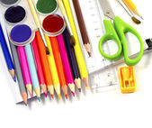 Assorted school supplies, including pens, pencils, scissors, glue and a rul — Stock Photo