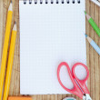 School accessories and checked notebook — 图库照片
