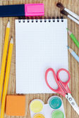 School accessories and checked notebook — Stock Photo