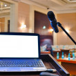 The rostrum with notebook waiting for a speaker - Stock Photo