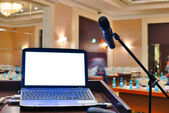 The rostrum with notebook waiting for a speaker — Stok fotoğraf