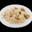 Pilaf on plate - dish of asian cuisine. Isolated on black backgr — Stock Photo