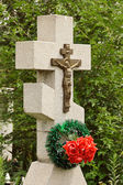 Closeup of granite cross with crucifix — Foto Stock