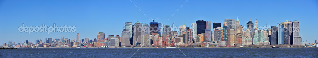 Skyscrapers of New York City Manhattan downtown with urban city skyline panorama over Hudson River with blue clear sky — Stock Photo #6817057