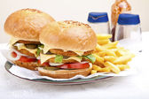 Two delicious huge chicken scallop burgers — Stock Photo