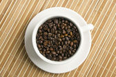 Coffee beans in a cup — Stock fotografie