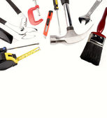 Varied tools on plain background. Copy space — Stock Photo