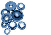 Steel gears meshing together on plain background — Stock Photo