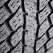 Closeup of rubber tire tread pattern — Foto Stock #7456943