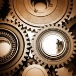 Постер, плакат: Closeup of steel gears meshing together