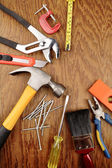 Assorted work tools on wooden panel — Foto Stock