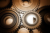 Closeup of steel gears meshing together — Stock Photo