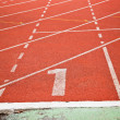Stock Photo: Running track numbers one in stadium