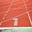 Stockfoto: Running track numbers one in stadium