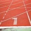 Running track numbers one in stadium — Stock Photo