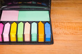Multicolored post it note block in black leather case — Foto de Stock