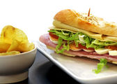 Sandwich with egg ham cheese tomato — Stock Photo